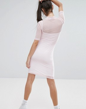 photo Mesh Overlay Mini Bodycon Dress with Front Logo Detail by Fila Petite, color Pastel Pink - Image 2