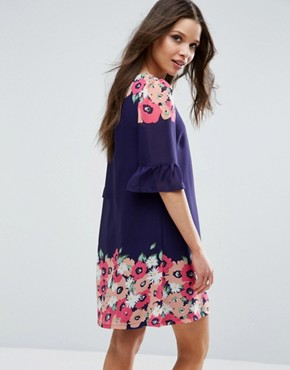 photo Swing Dress With Frill Sleeves In Border Print by Yumi Petite, color Navy - Image 2