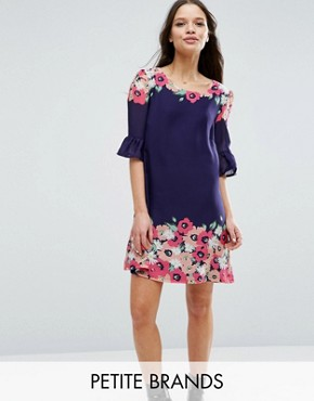 photo Swing Dress with Frill Sleeves In Border Print by Yumi Petite, color Navy - Image 1