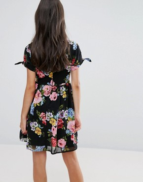 photo Skater Dress with Bow Sleeve In Floral Print by Yumi Petite - Image 2