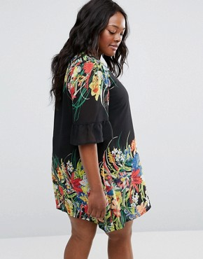 photo Swing Dress with Frill Sleeves In Border Print by Yumi Plus, color Black - Image 2