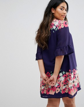 photo Swing Dress With Frill Sleeves In Border Print by Yumi Plus, color Navy - Image 2