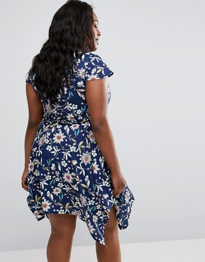 photo Hanky Hem Dress In Floral Print by Yumi Plus, color Navy - Image 2