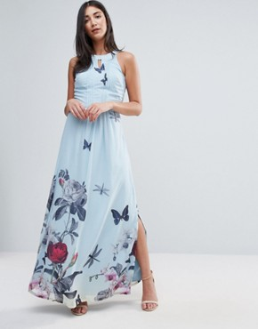 photo Maxi Dress with Pleated Neckline In Floral Print by Uttam Boutique, color Pale Blue - Image 1