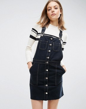 photo Denim Button Through Dungaree Dress with Raw Hem in Black by ASOS, color Black - Image 1