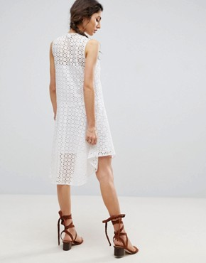 photo Sleeveless Broderie Dress with Dipped Hem and Pom Pom Trim by ASOS, color White - Image 2