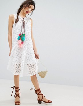photo Sleeveless Broderie Dress with Dipped Hem and Pom Pom Trim by ASOS, color White - Image 1