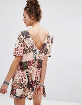 photo Dress with Button Up Back In Patchwork Floral Print by Motel, color Pink - Image 1