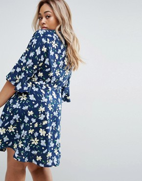 photo Wrap Dress In Floral Print by Yumi Plus, color Navy - Image 2