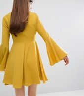 photo Tie Front Swing Dress by E.F.L.A, color Marigold - Image 2