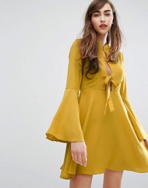 photo Tie Front Swing Dress by E.F.L.A, color Marigold - Image 1