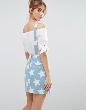 photo Denim Pinafore Dress In Star Print by The English Factory, color Blue - Image 2