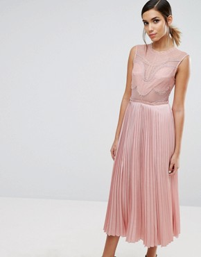 photo Lace Detail Midi Dress with Plated Skirt and Thigh Split by Three Floor, color Pink - Image 1