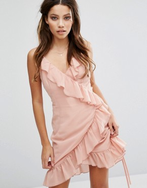 photo Cami Strap Ruffle Detailed Wrap Chiffon Dress by Club L, color Salmon Pink - Image 1