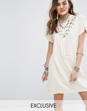photo T-Shirt Dress with High Neck and Lattice Tie Cut Outs by Sacred Hawk, color Cream - Image 1