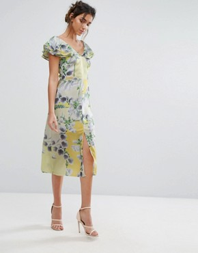 photo Floral Ruffle Midi Dress by Every Cloud, color Yellow Base Floral - Image 1