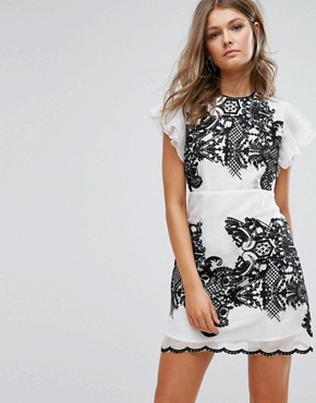 photo Embroidered Mini Dress with Ruffle Sleeves by Foxiedox, color White/Black - Image 1