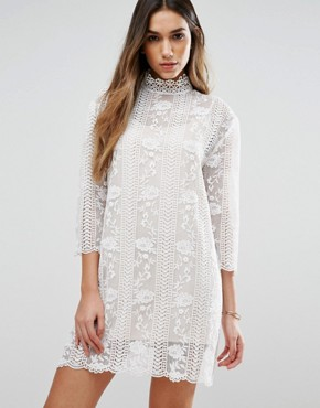 photo Table Maner High Neck Lace Dress by Jovonna, color White - Image 1