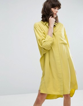 photo Cupro Peachey Feel Shirt Dress by Weekday, color Yellow - Image 1