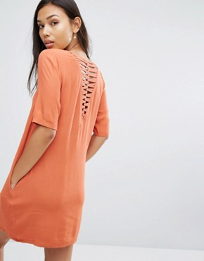 photo Lattice Back T-Shirt Dress by See U Soon, color Brick Red - Image 1