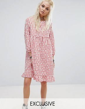 photo Vintage Smock Dress In Floral Gingham by Milk It, color Red - Image 1