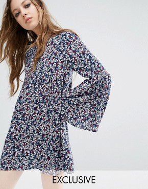 photo Vintage Smock Dress In Floral by Milk It, color Blue - Image 1