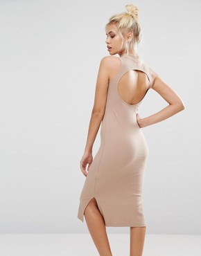photo Ribbed High Neck Dress In Camel by Puma, color Beige - Image 2