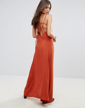 photo in Your Eyes Open Back Maxi Dress with Cross Back Details by WYLDR, color Orange - Image 1