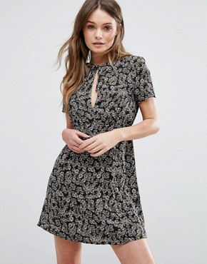 photo Paradise Lost Daisy Printed Tea Dress with Capped Sleeves and Keyhole Front by WYLDR, color Multi - Image 1