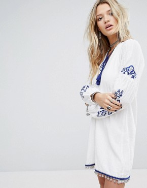 photo Smock Dress with Tassel Tie Neck and Embroidery by Honey Punch, color White - Image 1