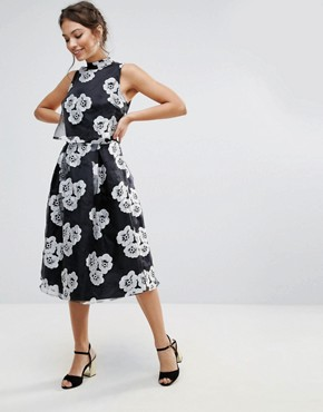 photo Amy Lynn High Neck Skater Dress in Floral Print by Amy Lynn Occasion, color Black - Image 1