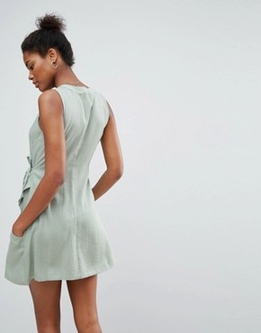 photo Vanish Wrap Dress by A State Of Being, color Eucalyptus - Image 2