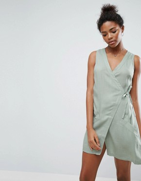 photo Vanish Wrap Dress by A State Of Being, color Eucalyptus - Image 1