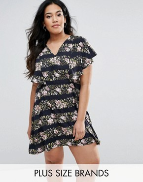 photo Cape Dress in Floral Stripe Print by Yumi Plus, color Navy - Image 1