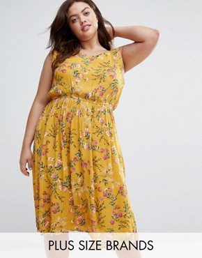 photo Dress with Dip Hem in Floral Print by Yumi Plus, color Yellow - Image 1