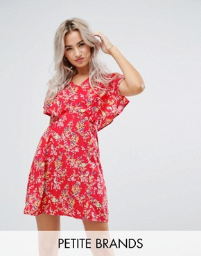 photo Cape Dress in Floral Print by Yumi Petite, color Red - Image 1