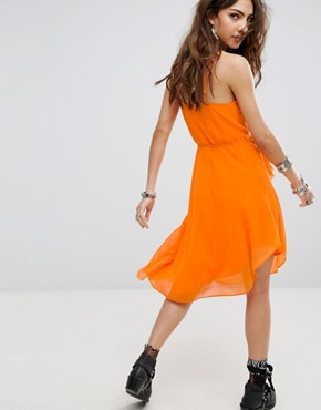 photo Wrap Front Cami Dress with Asymmetric Ruffle Trim by Sacred Hawk Festival, color Orange - Image 2