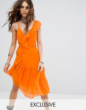 photo Wrap Front Cami Dress with Asymmetric Ruffle Trim by Sacred Hawk Festival, color Orange - Image 1