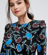 photo Organic Cotton Frill Shoulder Skater Dress in Bold Floral Print by People Tree, color Black Floral - Image 3