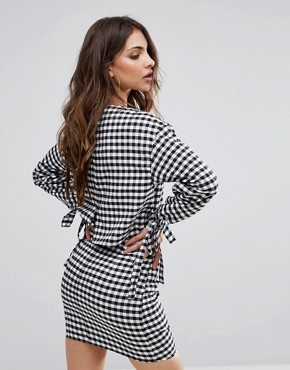 photo Gingham Long Sleeve Open Back Dress by PrettyLittleThing, color Black - Image 2