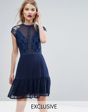 photo Lace Contrast Mini Dress with Pep Hem by Elise Ryan, color Navy - Image 1
