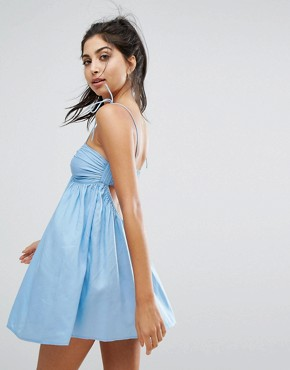 photo Beach Strappy Cami Dress with Twist Front in Chambray by ASOS, color Chambray - Image 1