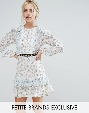 photo Frill Hem Skater Dress with Metal Belt Detail in Ditsy Floral Print by True Decadence Petite, color White Ditsy Floral - Image 1