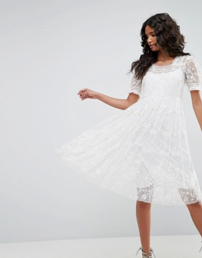 photo Tulle Embroidery Dress by Needle & Thread, color Ivory - Image 1
