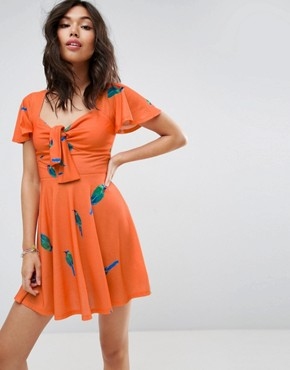 photo Bow Front Mini Skater Dress in Parrot Print by ASOS, color Multi - Image 1