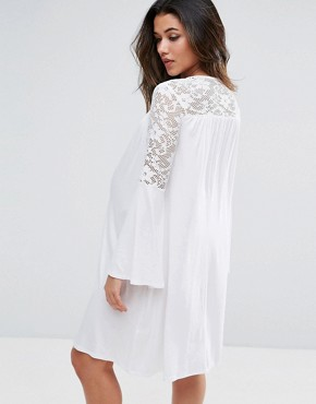photo Lace Insert Smock Dress with Fluted Sleeve by Bluebelle Maternity, color White - Image 2