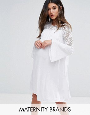 photo Lace Insert Smock Dress with Fluted Sleeve by Bluebelle Maternity, color White - Image 1