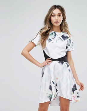 photo Printed Floral High Low Hem Dress by Oh My Love, color Diamond Floral - Image 1