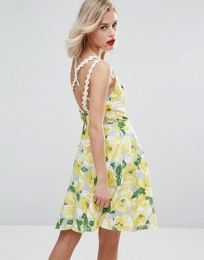 photo Skater Cotton Mini Dress with Daisy Trim in Yellow Floral by Horrockses, color Yellow Floral - Image 1