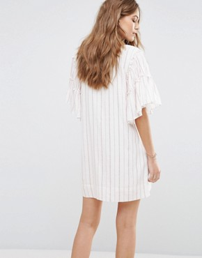 photo Embroidered Neck Opening Mini Dress by Moon River, color White Multi - Image 2